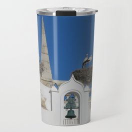 storks build nests on the church in the old town of faro, portugal, europe Travel Mug