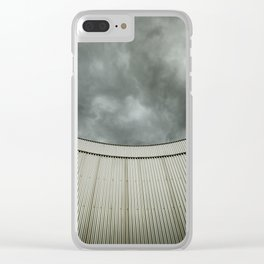 Building with metal covering against stormy sky Clear iPhone Case