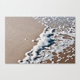 Foam on the beach on the Sunshine Coast Canvas Print
