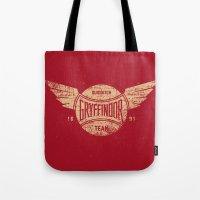 quidditch Tote Bags featuring Vintage Gryffindor Quidditch Team by Gurven