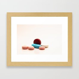Numerous medicines Medications in the form of tablets. Colored pills on a white background. Framed Art Print