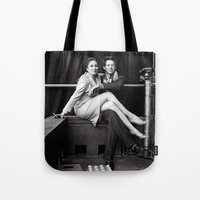 wes anderson Tote Bags featuring WES & ANJELICA by VAGABOND