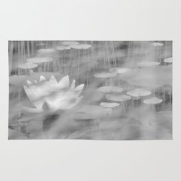 black and white lily pond Rug