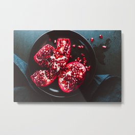 Top down view on a ripe pomegranate in a black plate on a dark background. Dark food photography. Metal Print