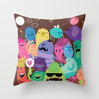 monsters Throw Pillows featuring Monsters by Maria Jose Da Luz