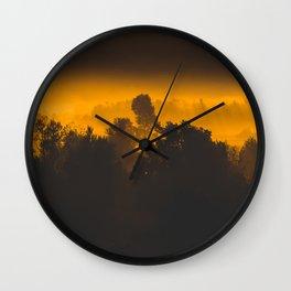 Sunrise behind foggy trees Wall Clock