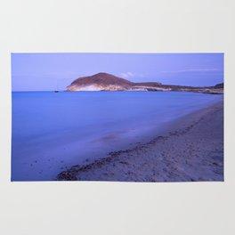 """Blue sea at sunset"" Rug"