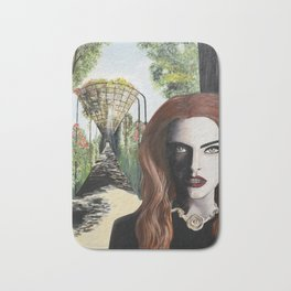 Mysterious lady in black in the garden Bath Mat
