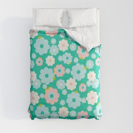 Small blue, white and pink flowers over a turquoise background Comforters