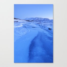 Frozen river in Thingvellir, Iceland in winter at dawn Canvas Print