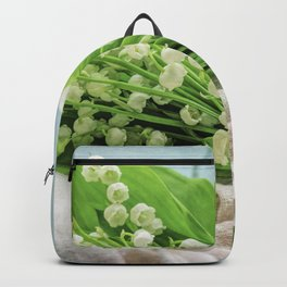 a bunch of lily of the valley Backpack