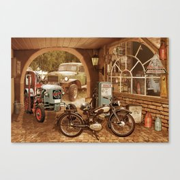 Nostalgic garage with tractor and motorcycle Canvas Print