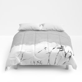 White marble spill on concrete Comforters