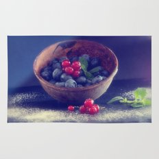 Dark blue berries contrasting with bright red berries Rug
