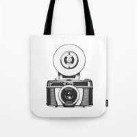 vintage camera Tote Bags featuring Camera by danielrafalski