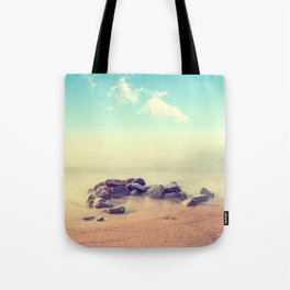 Minimalist misty seascape with rocks at long exposure. Coastal Sunrise. Tote Bag