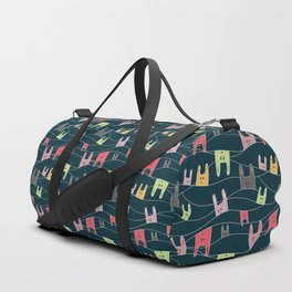 Colorful bunnies on navy background Duffle Bag