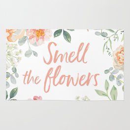 Floral frame with quote Smell the flowers Rug
