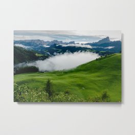 Full green mountain top with clouds beneath Metal Print