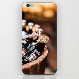 Bottles of Coca Cola in a Wooden Barrel iPhone Skin