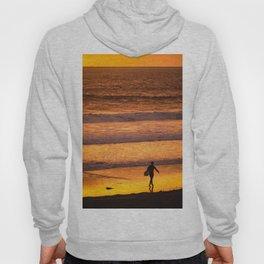 Surfer walking along beach at sunset Hoody