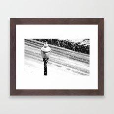 Lightpost in the snow storm. Framed Art Print