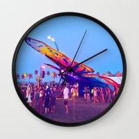 coachella Wall Clocks featuring coachella butterfly by katelyndee