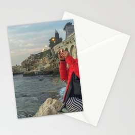Woman taking a picture in a beach in the Rovinj city center Stationery Cards