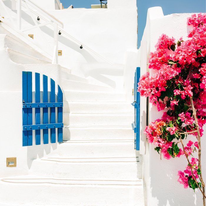 Colorful Blue Gate and White Staircases in Oia Santorini Island Greece Comforters