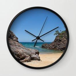 Tropical beach with rock Wall Clock