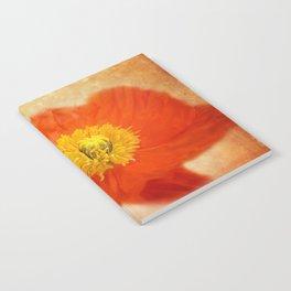 poppy blossom on orange Notebook
