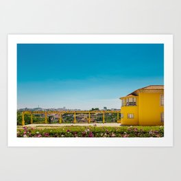 Yellow house with a view Art Print