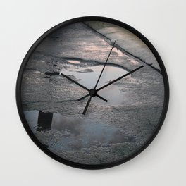 sun over rain puddles Wall Clock