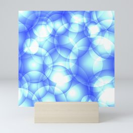 Gentle intersecting blue translucent circles in pastel colors with a heavenly glow. Mini Art Print