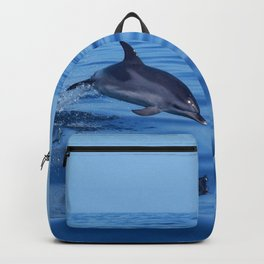 Spotted dolphin jumping in the Atlantic ocean Backpack