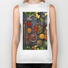 Fresh delicious ingredients for healthy cooking  on rustic background Biker Tank