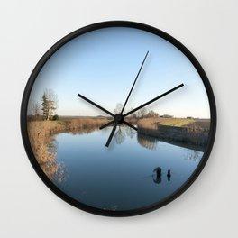A blue river landscape Wall Clock