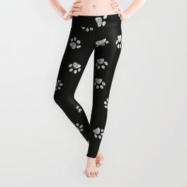 Doodle white paw print seamless fabric design pattern with black background Leggings