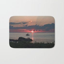 Sunset on the rocks Bath Mat
