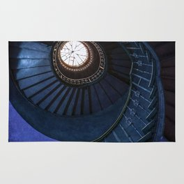 Abandoned blue spiral staircase Rug