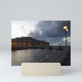 San Sebastian, Donestia, north Spain. A walk by the sea, bridge, street lights, romantic sunset. Mini Art Print