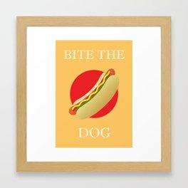Bite the dog Framed Art Print
