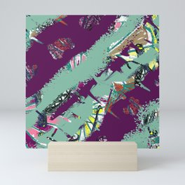 Smears of Paint Over A Picture in purple and green Mini Art Print