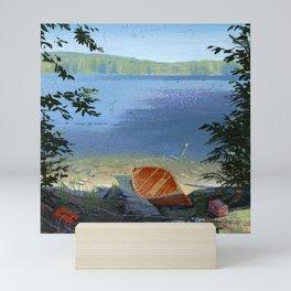 canoe on shore Mini Art Print