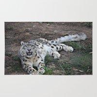 snow leopard Area & Throw Rugs featuring Snow Leopard by Kaleena Kollmeier