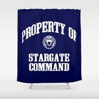 stargate Shower Curtains featuring Property of Stargate Command Athletic Wear White ink by RockatemanDesigns