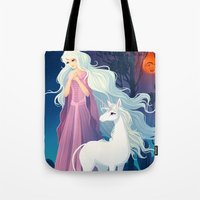 the last unicorn Tote Bags featuring The Last Unicorn by Tami Wicinas