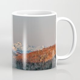 Sunset at spruce forest and mountains. Coffee Mug