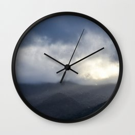 Light Streaming over mountains Wall Clock