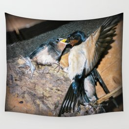 Swallow feeds chick. Wall Tapestry
